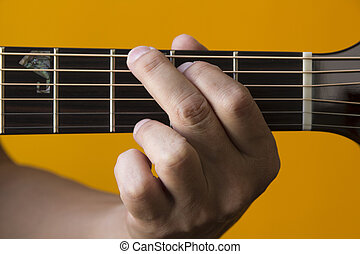 G chord on guitar - Hand performing G chord on guitar