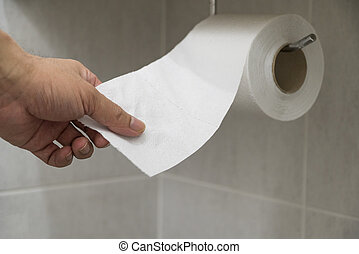 Hand picked toilet paper in the bathroom.