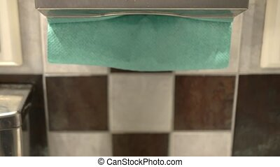 Hand Picking a Paper Towel - A hand picking a paper towel in...