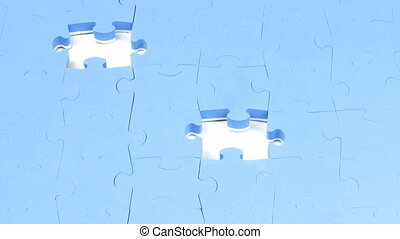 Hand placing the last two pieces on a puzzle