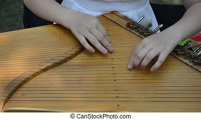hand play baltic psaltery - girl hands play with Baltic...
