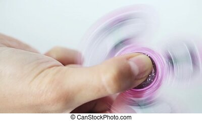 hand playing with spinning fidget spinner - toys,...