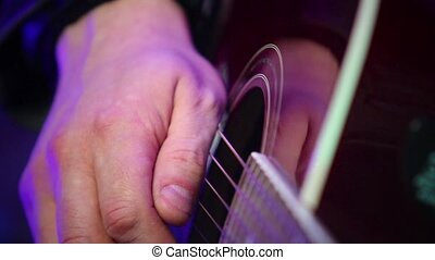 hand plays the guitar