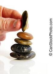 hand, plazierung, a, klein, stein, auf, a, stapel, von, drei