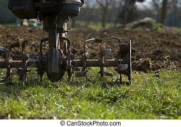 Hand plowing.