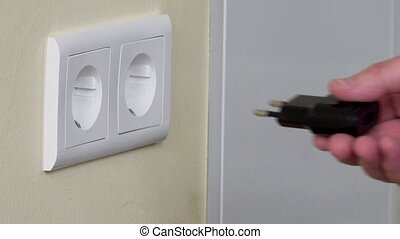 hand plug usb charger adapter and wire into wall socket. -...