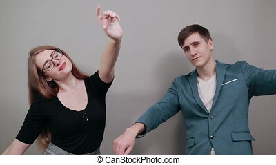Hand pointer with forefinger pointing forward. Index finger to show direction. Means choosing, introducing too. Indicating towards. Young attractive couple boyfriend girlfriend two people