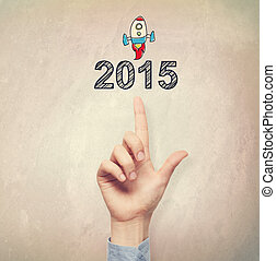Hand pointing to 2015 concept