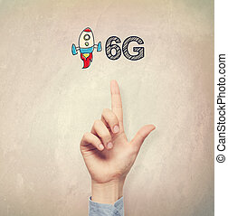 Hand pointing to 6G concept