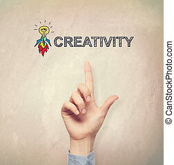 Hand pointing to Creativity concept