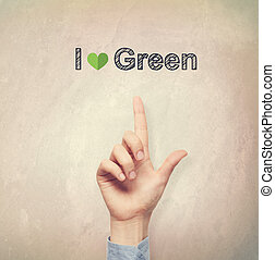 Hand pointing to I Love Green concept