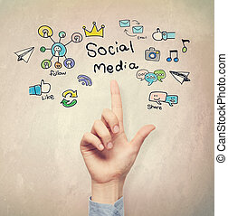 Hand pointing to Social Media concept