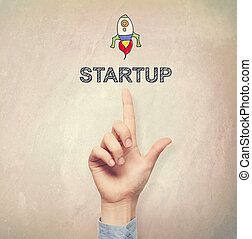 Hand pointing to Startup concept