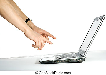 Hand pointing to the computer