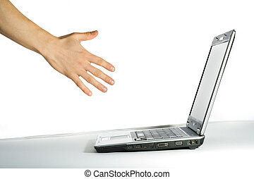Hand pointing to the computer.