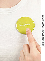 Hand pointing to volunteer button
