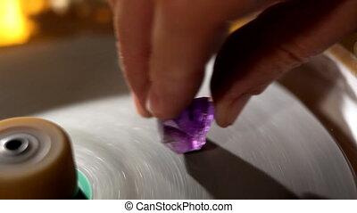 Hand polish gem - macro with water