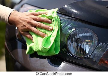 Hand polishing car.