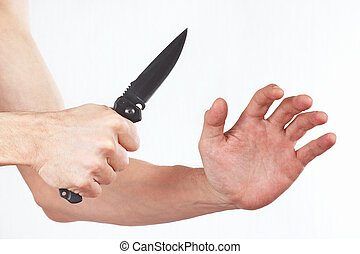 Hand position for the defense with a knife on white ...