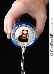 Hand pouring beer from can