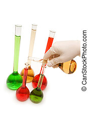 Hand pouring chemicals isolated on the white