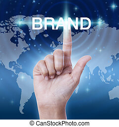 hand pressing brand word button. business concept