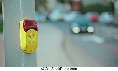 Hand Pressing Button at Traffic Lights