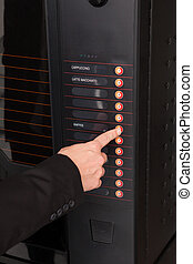 Hand pressing button of vending machine for coffee - Close-...