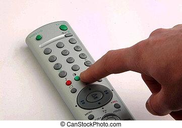 hand pressing button tv