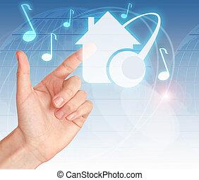 Hand pressing digital button HOME MUSIC