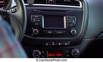 Hand Pressing the Lock Door Button in her Car. - Hand...