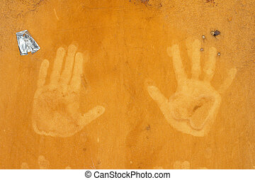 hand prints on an orange background