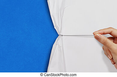 hand pull rope open wrinkled paper show blue background as business concept