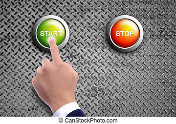 hand pushing start button on diamond steel background