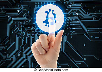 Hand pushing virtual button with Bitcoin symbol