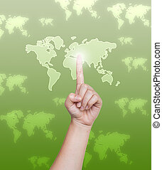 Hand pushing world map button on a touch screen interface