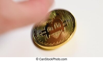Hand put bitcoin coin on table - Hand put bitcoin on table,...