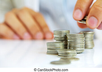 investment concept - Hand put coin to stack, investment...