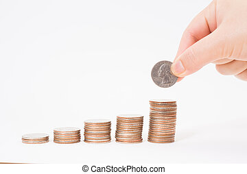Hand put dollar coin on stack of coins use for money financial banking concept