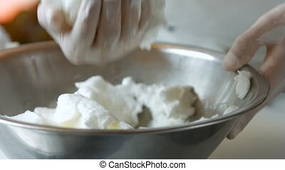 Hand puts meringue on salt.