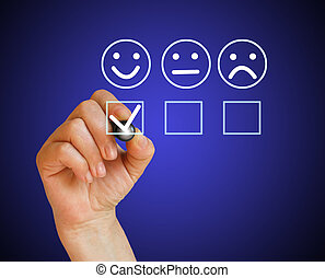 Hand putting check mark with white marker on customer service evaluation form