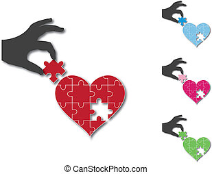 Hand putting in missing piece in heart