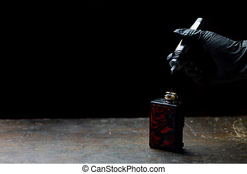 hand putting liquid of e-cig vape.