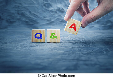 Q&A - acronym from wooden blocks with letters, questions and answers Q&A concept,