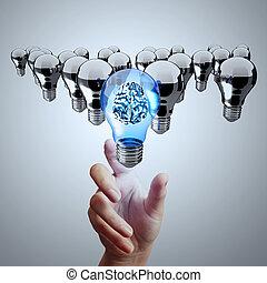hand reach 3d metal brain inside  light bulb of leadership concept