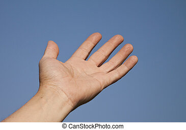 Hand reaching into a blue sky for help