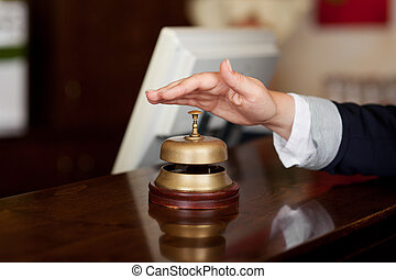 Hand ready to press the bell at the reception