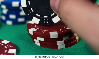 Hand Recounts Poker Chips, Close Up
