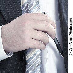 Hand removing a pen from his inside pocket