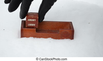 hand retro calendar snow - Hand put retro vintage wooden...